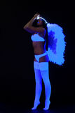Woman in sexy lingerie with wing under ultraviolet Royalty Free Stock Image