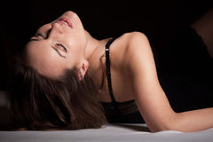 Woman in sexy nightwear lying on her back Royalty Free Stock Image