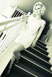 Woman in sexy pose on staircase Stock Photos