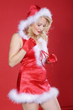 Woman in sexy santa claus outfit Royalty Free Stock Photos