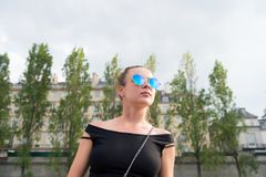 Woman in vest in paris, france. Sensual woman wear sunglasses on cityscape. Wanderlust or vacation and travelling concept. Su. Mmer fashion and style royalty free stock photography