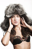Woman in sexy winter outfit Stock Photography