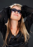 Woman in shades Stock Images