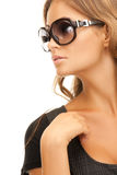 Woman in shades. Portrait of lovely woman in shades over white royalty free stock photo