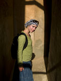 Woman on the shadow. Young woman on the shadow. City wall in Marrakesh Royalty Free Stock Photos