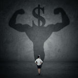 Woman with a shadow of athlete and dollar sign Royalty Free Stock Photos