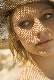 Woman with shadow pattern on face. royalty free stock photos