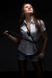 Woman in shadow with whip. Isolated photo Stock Photography