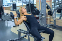 Woman shakes her pectoral muscles in gym Royalty Free Stock Images