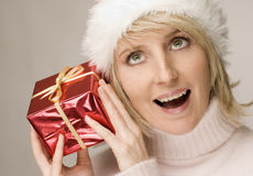 Woman shaking gift Stock Image
