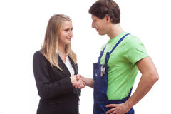 Woman shaking hands with physical worker. Woman in elegant dress shaking hands with physical worker stock photos