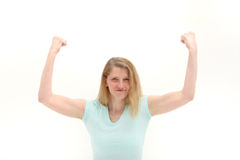 Woman shaking her fists in frustration. Woman shaking her raised fists in the air in frustration isolated on white Royalty Free Stock Photo