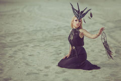 Woman shaman conjures. Royalty Free Stock Photos
