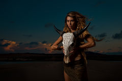 Woman shaman hold cow skull Royalty Free Stock Photography
