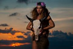 Woman shaman hold cow skull Stock Photos