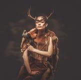 Woman shaman in ritual garment. With hawk royalty free stock image