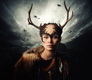 Woman shaman in ritual garment Stock Photo