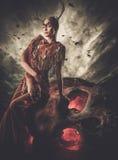 Woman shaman in ritual garment royalty free stock photos