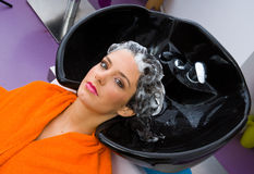 Woman with shampoo on her head Royalty Free Stock Images