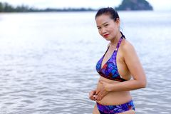 Woman shape beautiful with bikini relax on beach. At Bang Boet Beach, Chumphon Province Thailand Royalty Free Stock Photos