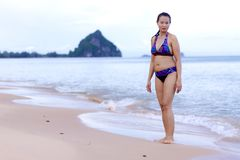 Woman shape beautiful show with bikini relax on beach Stock Image