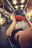 Woman shape six pack muscles with ball stock photos
