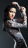 Woman in shape of snake Stock Photography
