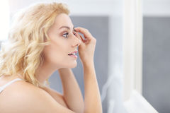 Woman shaping eyebrows Stock Photography