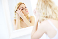 Woman shaping eyebrows Stock Photos