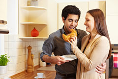 Woman sharing croissant with man Royalty Free Stock Photos