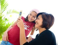 Woman sharing information on her cell phone stock image