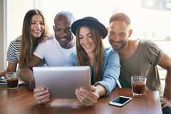 Woman sharing something on tablet with friends Royalty Free Stock Images