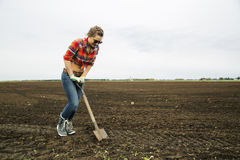Woman with sharp shovel try dig ground Stock Images
