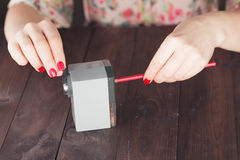 Woman  sharpening color pencil Royalty Free Stock Images