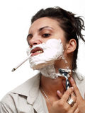 Woman shaving. With a cigarette in her mouth Royalty Free Stock Photo