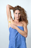 Woman shaving the hairs under her armpit Stock Photo