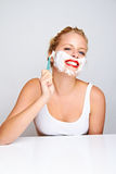 Woman shaving her face Royalty Free Stock Image