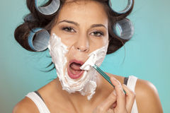 Woman shaving her face Stock Photo