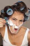 Woman shaving her face Royalty Free Stock Photo