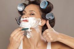 Woman shaving her face Stock Photos