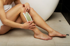 Woman shaving her leg. Stock Images