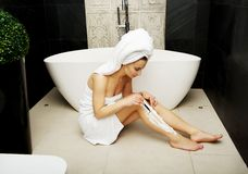 Woman shaving her leg. Royalty Free Stock Images