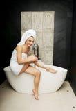 Woman shaving her leg. Royalty Free Stock Photography