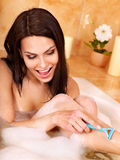 Woman shaving her legs Stock Photo