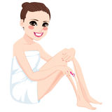 Woman Shaving Legs With Razor Stock Images
