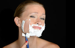 Woman Shaving. Nice humourous Image of a woman shaving stock images