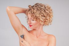Woman shaving razor armpit. Depilation and skin care concept royalty free stock photography