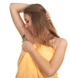 Woman shaving underarm with razor Royalty Free Stock Images