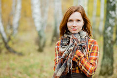 Woman in a shawl. Natural light photo of russian red-haired woman in a shawl Royalty Free Stock Image