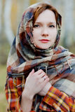 Woman in a shawl. Natural light photo of russian red-haired woman in a shawl Stock Images